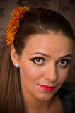 Woman with orange flowers in hair Royalty Free Stock Images