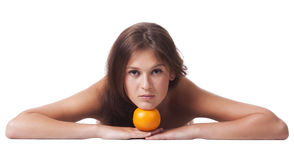 The woman with an orange fruit Stock Images