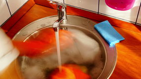 Woman With Orange Gloves Is Dishwashing, Time Lapse,Zoom In stock footage