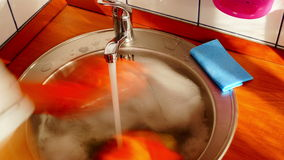 Woman With Orange Gloves Is Dishwashing, Time Lapse,Zoom Out stock video