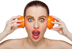 Woman with orange halves Stock Image