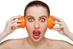 Woman with orange halves stock image