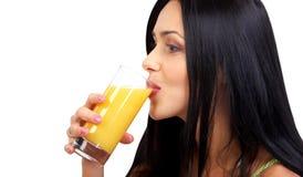 Woman with orange juice Stock Photography
