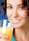 Woman orange juice Royalty Free Stock Photos
