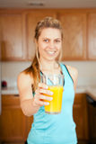 Woman orange juice Stock Photos