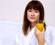 Woman with orange juice Royalty Free Stock Photography