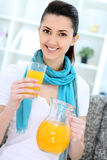 Woman with orange juice Stock Photos