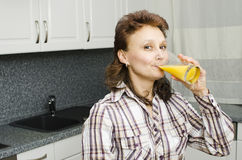 A woman with an orange juice Stock Image