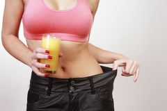 Woman with orange juice Stock Photography
