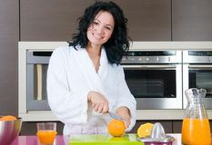 Woman with orange juice at domestic kitchen Royalty Free Stock Photo