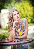 Woman with orange juice in outside bar Stock Photo