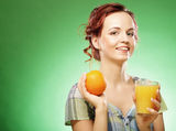 Woman with orange juice over green background Royalty Free Stock Photos