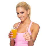 Woman with orange juice and thumbs up Royalty Free Stock Photography