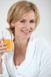 Woman with orange juice Stock Images