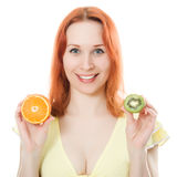 Woman with orange and kiwi fruit in the hands Stock Images