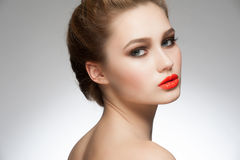 Woman with orange lipstick Royalty Free Stock Photo