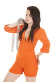Woman orange prison chain side Stock Photo