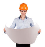 Woman in an protective helmet looks drawing Royalty Free Stock Photos