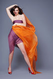 Woman with orange scarf. Stock Images