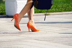 Woman in orange shoes Royalty Free Stock Photography