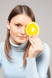 Woman with orange slice Stock Images
