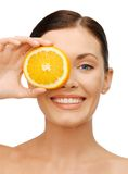 Woman with orange slice Royalty Free Stock Photo