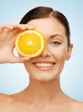 Woman with orange slice Stock Photography