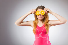 Woman with orange slices - neutral face Stock Photos