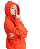 Woman in orange sweatshirt keeping silence Royalty Free Stock Images