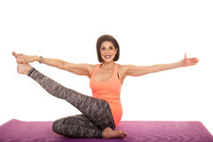 Woman orange tank top stretch leg up Royalty Free Stock Photography
