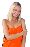 Woman in orange towel royalty free stock photography