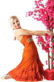 Woman in orange with tree Royalty Free Stock Images