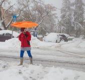 Woman with orange umbrella in Jerusalem Stock Photo