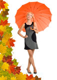 Woman with orange umbrella. Leaves background royalty free stock photography