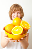 Woman with oranges Royalty Free Stock Image
