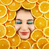 Woman and oranges Stock Image