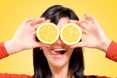 Woman with oranges in front of your eyes Royalty Free Stock Images