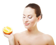 woman with oranges in her hands Royalty Free Stock Photos
