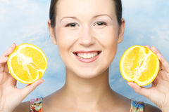 Woman with oranges in her hands Stock Photo