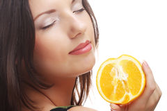Woman with oranges in her hands Royalty Free Stock Photography