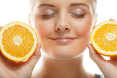 Woman with oranges in her hands studio portrait isolated on whit Royalty Free Stock Photos