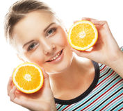 Woman with oranges in her hands studio portrait isolated on whit. People, health and diet concept: woman with oranges in her hands studio portrait isolated on Stock Image