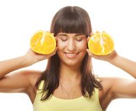 Woman with oranges in her hands studio portrait isolated on whit Stock Photography