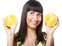 Woman with oranges in her hands studio portrait isolated on whit. People, health and diet concept: woman with oranges in her hands studio portrait isolated on Royalty Free Stock Images