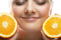 Woman with oranges in her hands studio portrait isolated on whit. People, health and diet concept: woman with oranges in her hands studio portrait isolated on Royalty Free Stock Photo