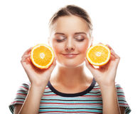 Woman with oranges in her hands studio portrait isolated on whit. People, health and diet concept: woman with oranges in her hands studio portrait isolated on Stock Photo