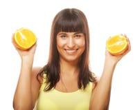 Woman with oranges in her hands studio portrait Stock Photo