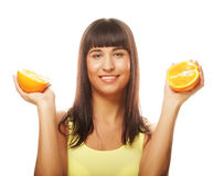 Woman with oranges in her hands studio portrait. People, health and diet concept: woman with oranges in her hands studio portrait isolated on white background Royalty Free Stock Photos