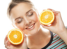 Woman with oranges in her hands studio portrait. People, health and diet concept: woman with oranges in her hands studio portrait isolated on white background Royalty Free Stock Photo