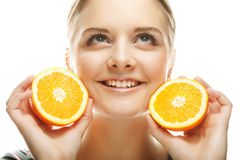 Woman with oranges in her hands studio portrait. People, health and diet concept: woman with oranges in her hands studio portrait isolated on white background Royalty Free Stock Photography